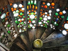 Glass bottle wall inside an earthship stairwell. Lovely.