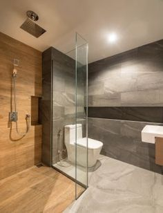 This modern bathroom uses a mixture of grey tiles, wood, and glass, to create a calm experience. Wood Tile Shower, Grey Bathroom Tiles, Grey Bathrooms, Bathroom Layout, Modern Bathroom Design, Bathroom Interior Design, White Bathroom, Small Bathroom, Grey Tiles