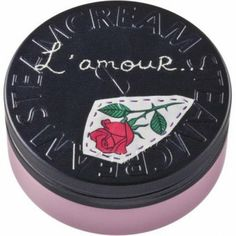 """Gallia shows a red gallia rose, symbol of love and beauty, on a stark black backround. Japanese poet and embroidery artist Mako Kikawa has worked the word """"amour"""" French for love, into the design for us.  #Beauty  #Vegan  #natural  #STEAMCREAM  #Moisturiser  #love"""