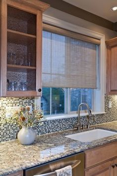 Window shade over kitchen sink - I like how it offers privacy but allows light to still come through.