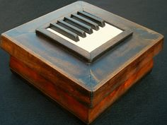 Art made from from old piano parts. See the website for more examples. Save the Wood!