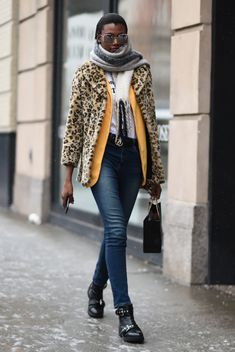 431261b8329 Ruth Akele is seen wearing an animal print coat outfit outside the.