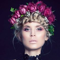 Editorial look with a braided updo and a crown of roses. Smoked out cranberry pink hues eye look.