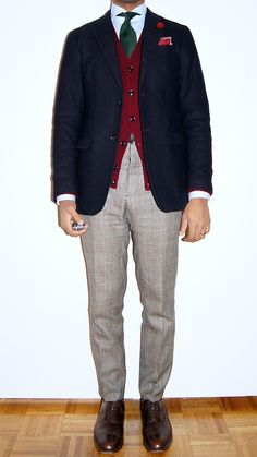Navy sport coat, light blue shirt, green tie, red sweater, light grey glen plaid pants