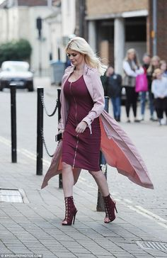 Dressed to impress: Chloe paired the garment with sexy lace-up stilettos that were a perfect colour match with her purple frock, while a pink duster jacket broke up the purple style