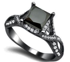 black diamond ring-- different. I Love It! (over the white diamond thing, I want a black diamond). EH.