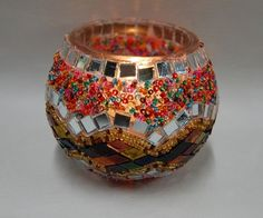 Another centerpiece component will be round mosaic candleholders resembling Sufi lamps mosaic candle holders - Google Search