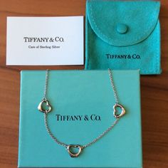 Tiffany and Co. Three Open Heart Necklace Vintage Sterling Silver Elsa Peretti Triple Open Heart Necklace. Used. Need to clear and polish. Comes with a box, pouch, ribbon and bag. Tiffany & Co. Jewelry Necklaces