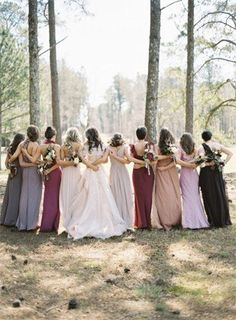 I love this idea of bridemaid dresses all different colours but in the same 'scheme'
