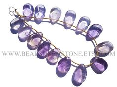 Ametrine Pear Smooth Beads Quality B 10x16 to 11.5x16.5 #ametrine #ametrinebeads #ametrinebead #ametrinepear #pearbeads #beadswholesaler #semipreciousstone #gemstonebeads #beadsogemstone #beadwork #beadstore #bead