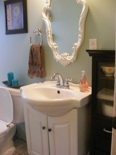 Love this vanity for a small bathroom. Pedestal sink look with storage.