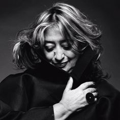 """Dame Zaha; born 31 October 1950) is an Iraqi-British architect. She received the Pritzker Architecture Prize in 2004—the first woman to do so—and the Stirling Prize in 2010 and 2011. Her buildings are distinctively futuristic, characterized by the """"powerful, curving forms of her elongated structures with """"multiple perspective points and fragmented geometry to evoke the chaos of modern life""""."""