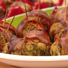 Stuffing Rumaki with leftover turkey stuffing. Stuffed in slices of bacon and water chenuts.