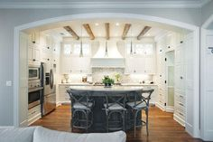 Design in this kitchen gives the room a French rustic feel.