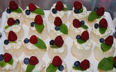 Pinner: Mini Angel Food Cake with Mascarpone Cream topped with mint leaf, raspberry and blueberries. Bake on cupcake liners, and when cooled peel off the liners and flip upside down, pipe cream and decorate! Cream Tops, Angel Food Cake, Cupcake Liners, Blueberries, Raspberry, Mint, Sweets, Baking, Desserts