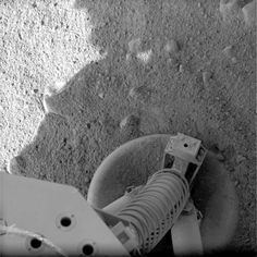 NASA's Mars Phoenix Lander can be seen parachuting down to Mars, in this image captured by the High Resolution Imaging Science Experiment (HiRISE) camera on NASA's Mars Reconnaissance Orbiter on May 25, 2008. This is the first time that a spacecraft has imaged the final descent of another spacecraft onto a planetary body.