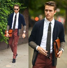 Choose a navy cardigan and burgundy chinos to create a chic, glamorous look. Let's make a bit more effort now and rock a pair of black suede derby shoes.  Shop this look for $364:  http://lookastic.com/men/looks/dress-shirt-and-tie-and-zip-pouch-and-chinos-and-derby-shoes-and-cardigan/4019  — White Dress Shirt  — Charcoal Tie  — Tobacco Leather Zip Pouch  — Burgundy Chinos  — Black Suede Derby Shoes  — Navy Cardigan