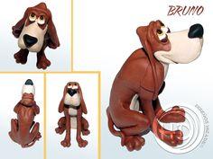 """Figura de Bruno, el simpático perro de la película de Disney """"Cenicienta"""". Figura de 12 cm aprox. Hecho totalmente a mano. Materiales: arcilla polimérica FIMO."""