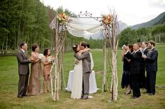 Lovely natural wood wedding arch