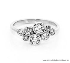 R8D001 - Unusual diamond bubble ring with scattered full bezel set round brilliant cut diamonds.