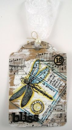 Suzz's Stamping Spot: These are a Few of My Favorite Things Part of tag book.  Paint and Tissue Tape on the background