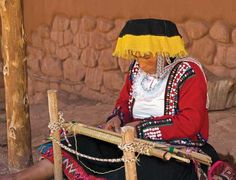 A local weaver works in the Awana Kancha center in Cuzco.