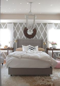 White and gray master bedroom design.