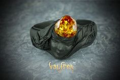 Scandinavian Royal Jewellery. Handcrafted near the coast of Nordic Baltic Sea. Adjustable Leather Bracelet with the depiction of Scandinavian Goddess Freya wearing an amber crown. #leather #jewellery #amber #handmade #bracelet #bangle #unique #fashion #unisex #leatherjewelry #oneofakind at valfrea.com.au