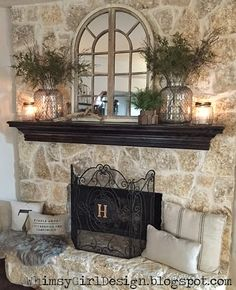 whimsy girl: Our Home: {Nature Inspired Spring Mantle} Fireplace décor, grainsack pillows, initial fireplace screen, natural décor, neutral colors, glass jars, fern sprigs, spring décor, arch windowpane mirror, faux fur rug.