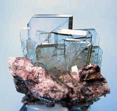 Cluster of transparent, almost colorless tabular BARITE crystals on matrix. Huánuco, Peru
