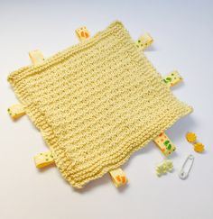 Yellow hand knitted taggy blanket, newborn gift, baby shower gift . by TheFlatOfKat on Etsy https://www.etsy.com/uk/listing/514178932/yellow-hand-knitted-taggy-blanket