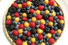 A fruit tart is a show stopping way to use husk cherries while they're in season. A lining of rich chocolate keeps the crust from getting soggy and is a nice partner to the fresh fruit.