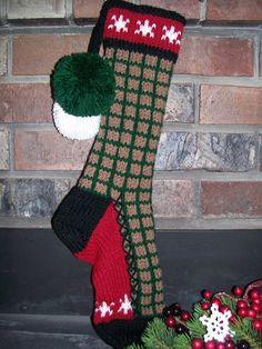 Old Fashioned Hand Knit Rustic Series Christmas Stocking From Santa's Stocking Works in a windowpane pattern body with Snowflake detail. This stocking has a Hunter Green & Cafe' Brown body, with Burgundy Red top and foot gusset back ground, Soft White Snowflakes and Black trim. These are are available for sale at http://www.etsy.com/shop/SantasSW and  www.santasstockingworks.com