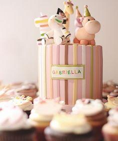 adorable pink jungle animals cake