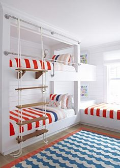 This coastal white bungalow has a light, airy feel. It has a nautical theme and features both blue and red trim throughout much of the space.