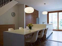 modern kitchen by blackLAB architects inc.  Great idea with the tall cabinets using the dead stair space
