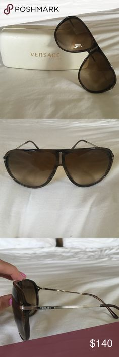 Versace Aviator Sunglasses Authentic Versace sunglasses in great condition. I've had them for a few years but just don't wear them anymore. Still in great condition and go perfect with any outfit! A few scratches on the left lens (pictured above) but it is barely noticeable. Under Ray-Bans for views, but they are authentic Versace glasses. Ray-Ban Accessories Sunglasses
