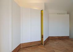 #tissellistudio white bedroom closets, wooden floor and a stripe of yellow coloured mirror