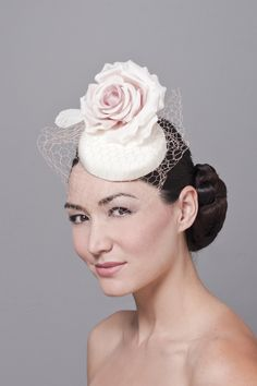 Rich ivory colored four-ply silk crepe fascinator with a pale pink silk rose and vintage French honeycomb veil. Silk taffeta lining.