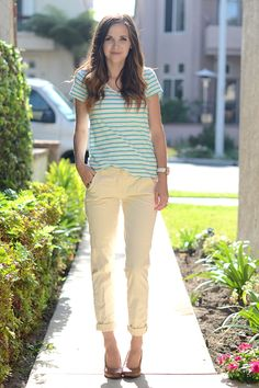 Cropped or rolled trousers are a great wardrobe piece. Instead of a structured top like a buttondown shirt, opt for a loose, casual tee, like this striped one, that helps balance out the professionalism. Then add a pair of wedges to elongate the leg and keep you looking long and lean.