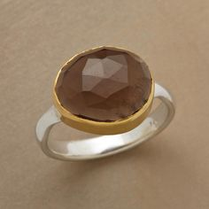 SIDEWAYS SMOKY QUARTZ RING--Triangular facets bounce light off a smoky quartz surrounded in 22kt goldplate and set sideways on a sterling silver band. Handcrafted exclusive. Whole sizes 5 to 9.