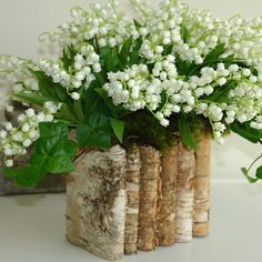 Love the look of the bark planter with the Lily of the Valley