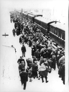 Poland, Jews rounded-up in a train station befoe their deportation.
