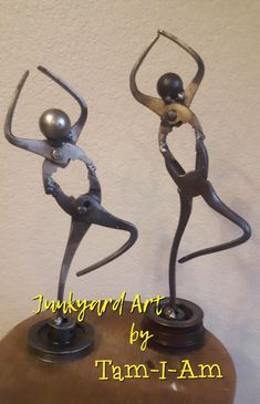 Junkyard Art by Tam-I-Am.  Repurposed pliers, ball bearing, and pulley come together as a dancer. Scrap metal art.