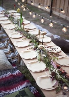 table, party, gathering, plates, festoon lighting,