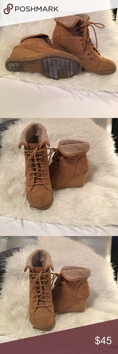 Woman's beautiful tan/suede boots Woman's comfy-cozy tan heeled lace up boots with 3 inch heels inside the insole. They can be worn folded down or flipped up. Either way they're sex!! You're gonna love these so hurry and grab them up before someone else does!! Cheers!! And always remember......Happy Poshing!! Shoes Lace Up Boots