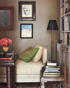 Bookcase Styling Ideas We Stole From the Pros : Use extra furniture, like a stylish vintage chair, to show off a stack of your favorite reads front and center. Grey Wall Color, Bookcase Styling, Grey Walls, Elle Decor, Beautiful Interiors, Interiores Design, Decoration, Art Decor, Interior Inspiration