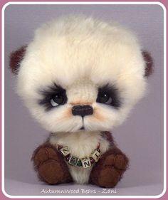 AutumnWood Bears.....(this cute little panda cub makes me giggle. tee.hee. see, there i go again!)....