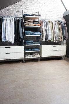 light cork flooring and open closet shelving