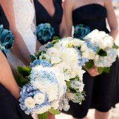 Katherine's bridesmaids carried fluffy bouquets of roses, hydrangeas, tweedia and dusty miller.  from the album: A Casual, Cape Cod Wedding